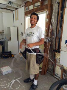 Esteban wiring up the kitchen.
