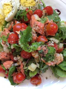 Salad with wild sockeye salmon and eggs.