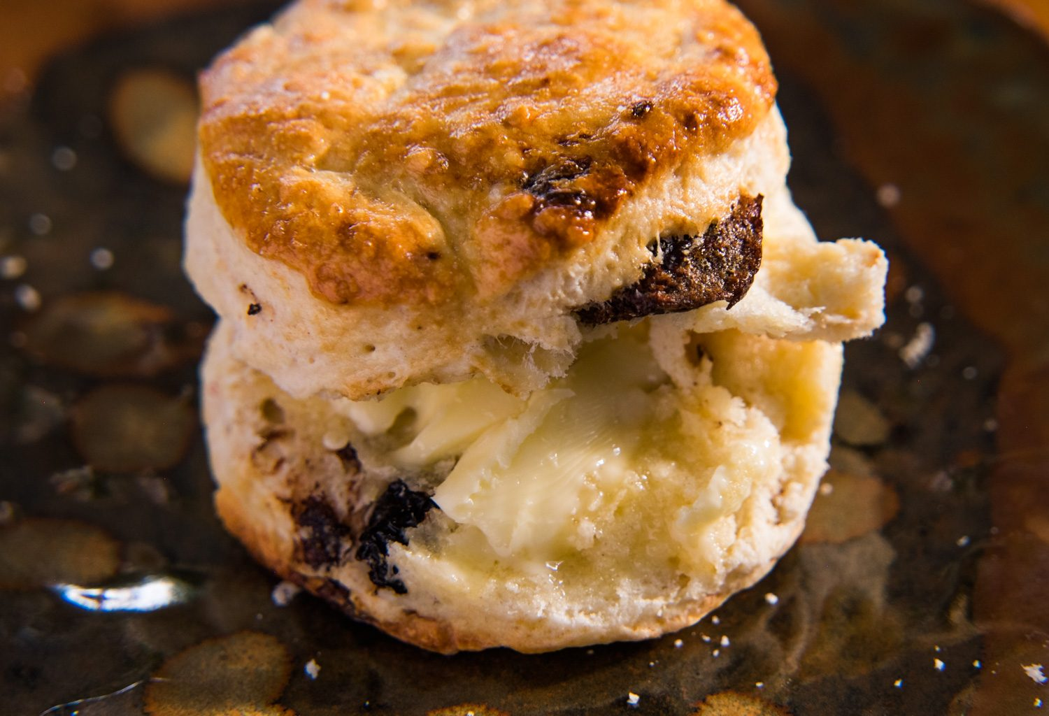 Date Scone dripping in organic salted butter.